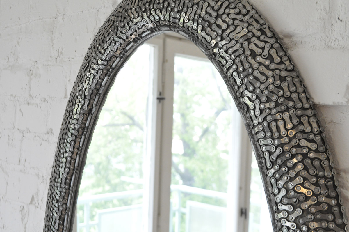 wooden mirror frame decorated with bike chain links