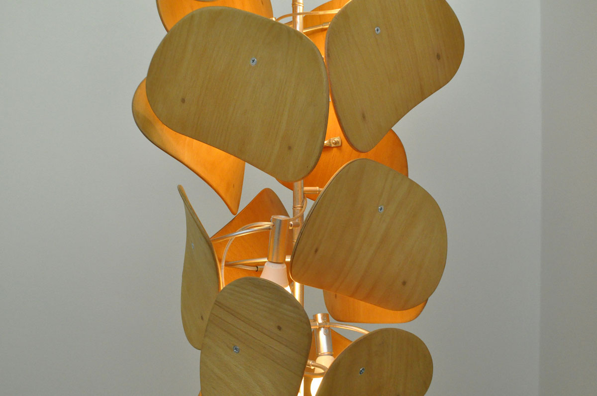 unique upcycled chandelier made from used school chair backrests
